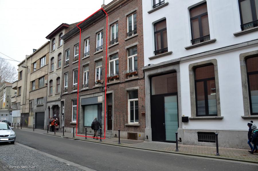 Bureau godin immeuble de rapport et composé de logements à